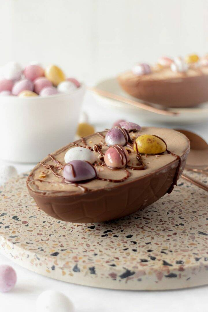 Chocolate cheesecake in a chocolate shell decorated with candy and chocolate sauce
